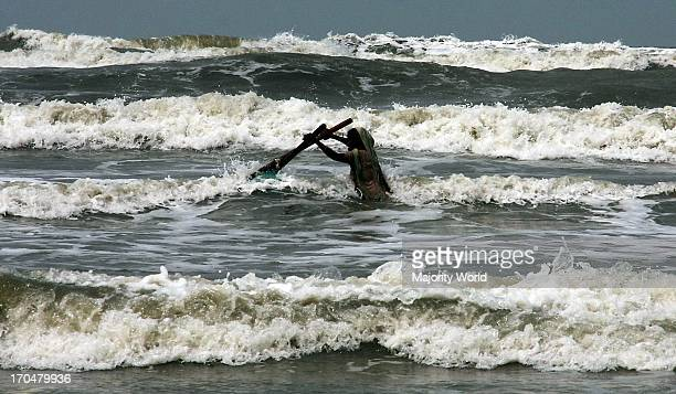A woman catching shrimp in the waters of the Bay of Bengal along Coxs Bazar beach in Chittagong Bangladesh April 18 2009