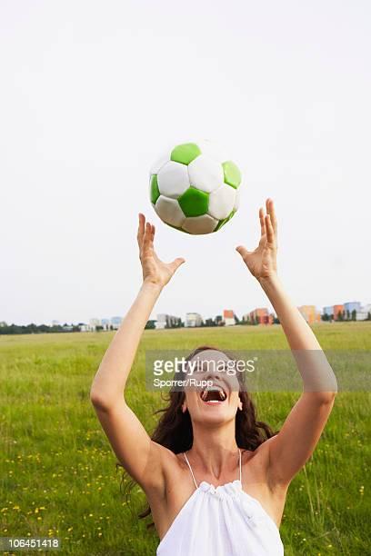 woman catching soccer ball - つかまえる ストックフォトと画像