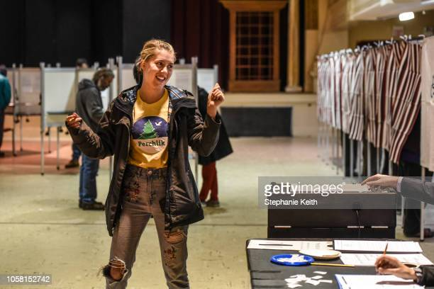 Woman celebrates after casting her vote at the Montpelier Town Hall on November 6, 2018 in Montpelier, Vermont. Turnout is expected to be high...