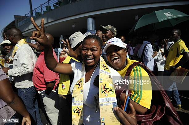 A woman celebrates after purchasing official 2010 FIFA World Cup tickets on April 15 2010 at the Maponya shopping mall in Soweto during the first day...