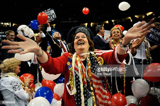 A woman celebrates at the end pf day four of the Republican National Convention at the Xcel Energy Center on September 4 2008 in St Paul Minnesota US...