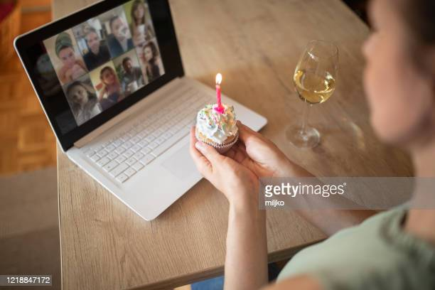 Woman celebrating birthday alone at home