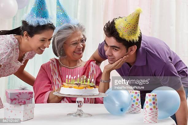 Woman celebrating birthday with grandchildren