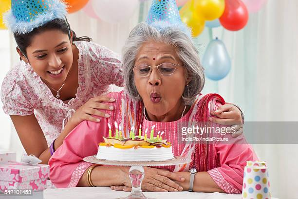 Woman celebrating birthday with granddaughter