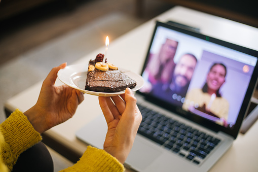 Woman celebrating birthday with video conference 1218531120