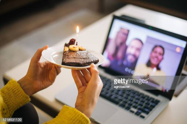woman celebrating birthday with video conference - happy birthday stock pictures, royalty-free photos & images
