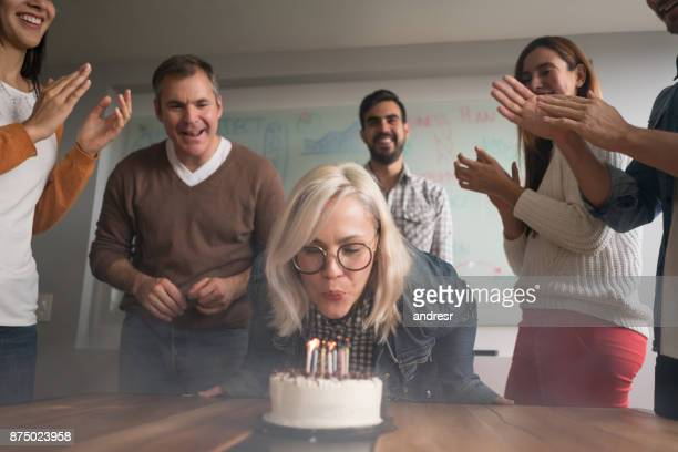 Woman celebrating her birthday at the office