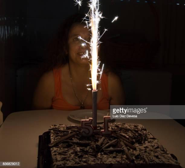 woman celebrating her birthday with sparkler fireworks