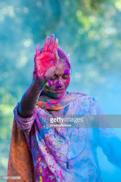 woman celebrating holi in jaipur, india - religious celebration stock pictures, royalty-free photos & images