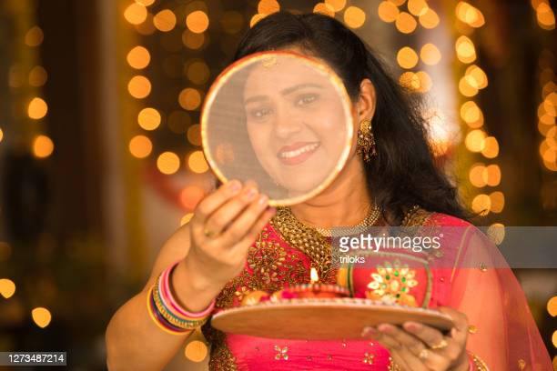 woman celebrating karwa chauth festival - ceremony stock pictures, royalty-free photos & images
