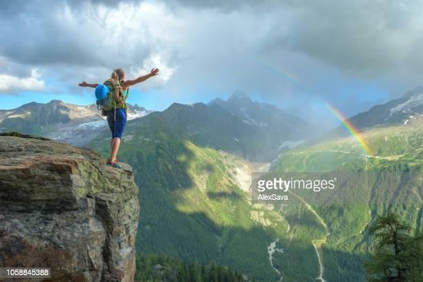 woman celebrating success on the mountain - repubblica di cipro foto e immagini stock