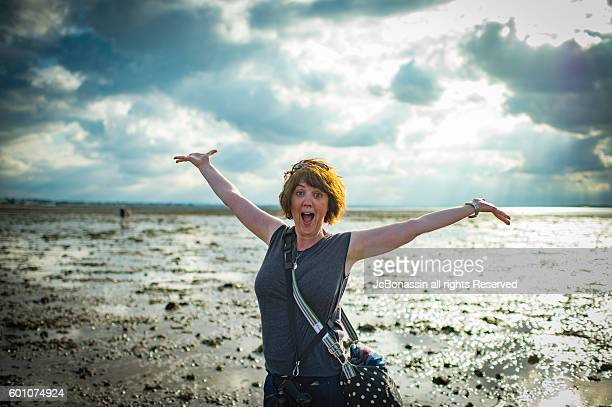 woman celebrating summer - jcbonassin stock pictures, royalty-free photos & images