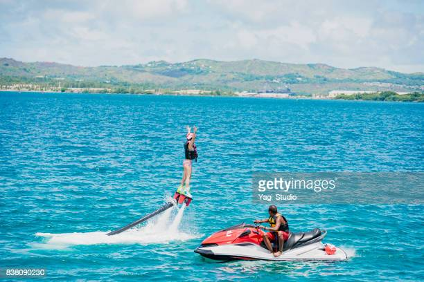 Woman challenging flyboard in guam