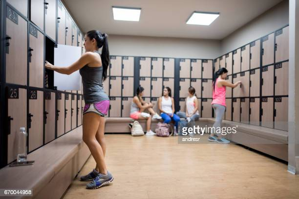 Woman changing in the locker room at the gym