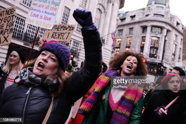 Woman chant as they make their way down Regent Street during the antiausterity 'Women's March for Bread and Roses' in London England on January 19...