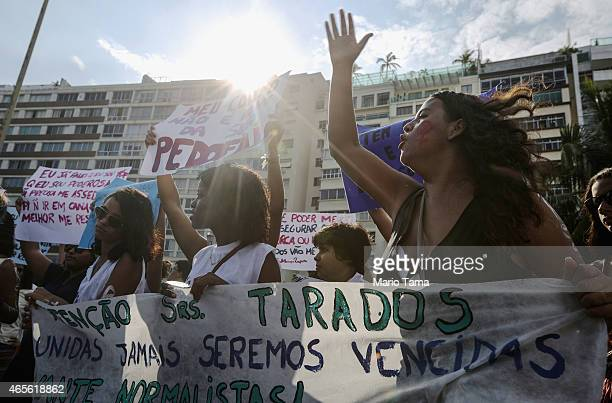 A woman chants during a march marking International Women's Day on March 8 2015 in Rio de Janeiro Brazil Marches and events were held worldwide to...