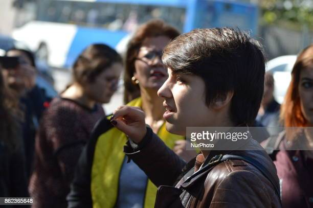 A woman chants slogans as Turkish riot policemen disperse woman protesters who were going to march to the Grand National Assembly of Turkey to...