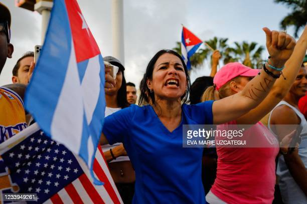 Woman chants slogans during a protest against the Cuban government at Versailles Restaurant in Miami, on July 12, 2021. - Havana on Monday blamed a...