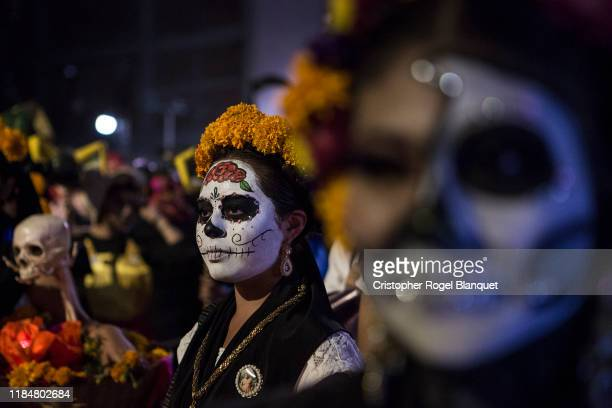 A woman characterized as Catrina during the 'Day of the Dead' celebrations on October 31 2019 in Oaxaca Mexico Every year people in Mexico remember...