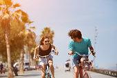 Woman chasing man while riding bicycle