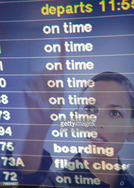 Woman Checking Airline Departure Times
