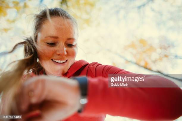 Woman checking data after jogging.