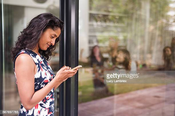 Woman checking her messages at a gathering