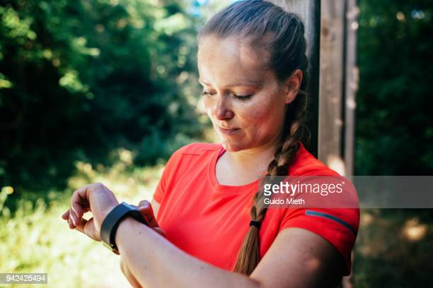 Woman checking her smartwatch outdoor.