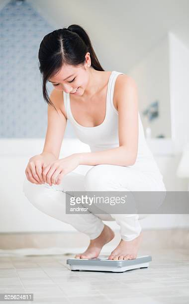 Woman checking her weight