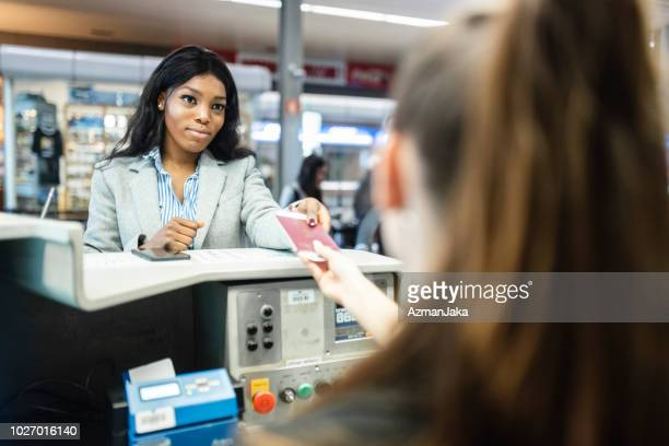 woman checking in at the airport - customs stock pictures, royalty-free photos & images