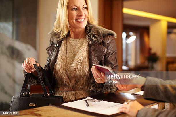 Woman checking in to hotel