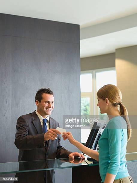 woman checking into a hotel - hotel key stock photos and pictures