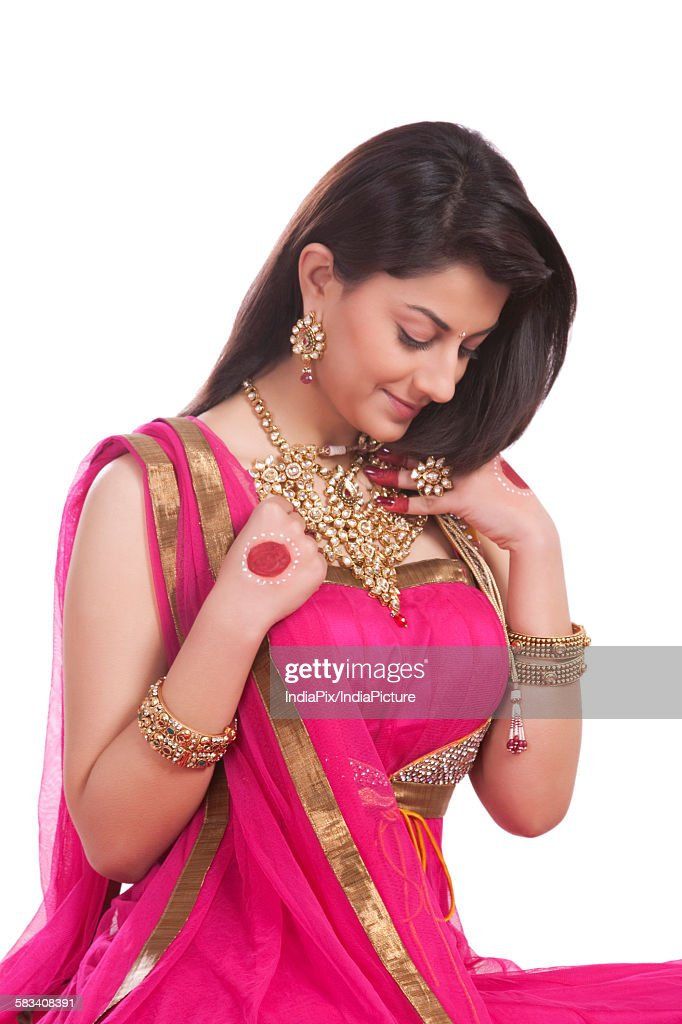 Woman checking jewelery against her neck : Stock Photo