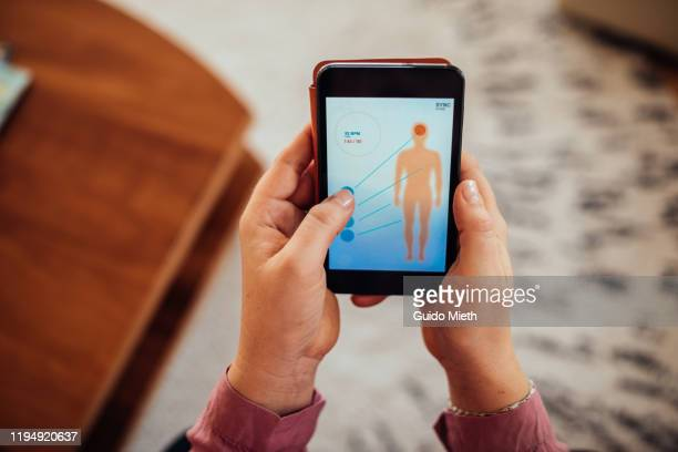 woman checking mobile health app. - wearable computer stock pictures, royalty-free photos & images