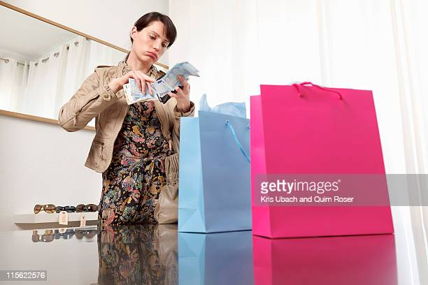 woman checking money from purse