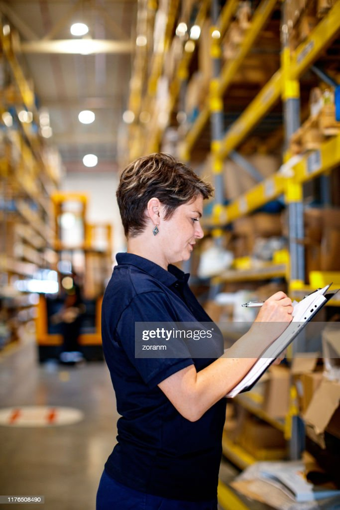 Woman checking packages : Stock Photo