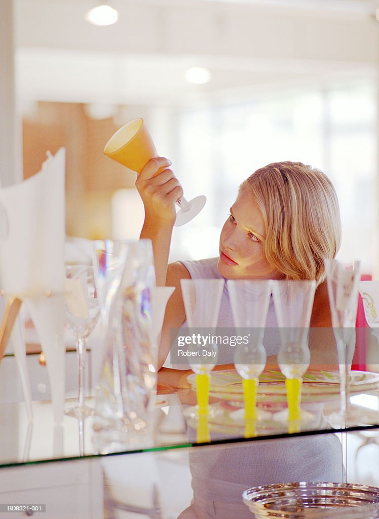 Woman checking price on glass in shop, close-up : Stock Photo