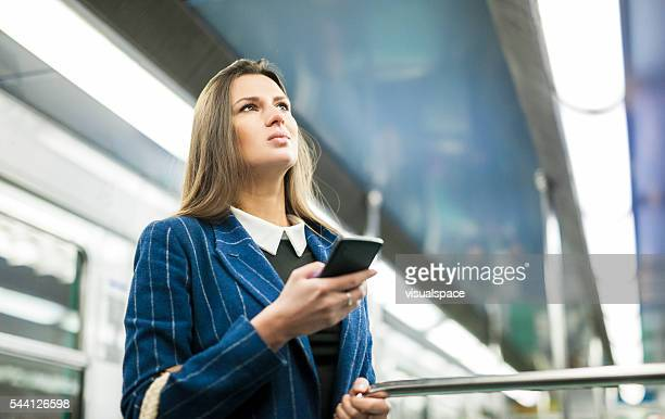Woman Checking Public Transport Plans Before Getting Off Train