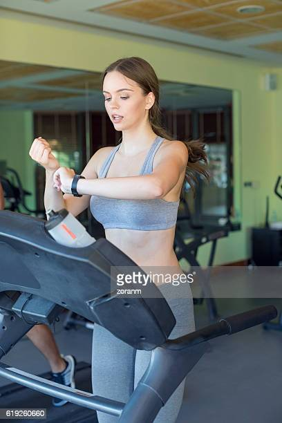 Woman checking pulse in gym