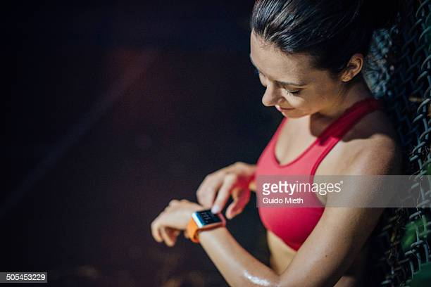 woman checking pulse. - checking sports stock pictures, royalty-free photos & images