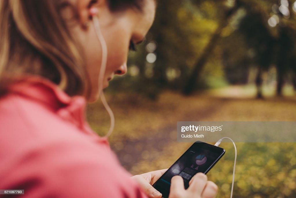 Woman checking self tracking app. : Stock Photo