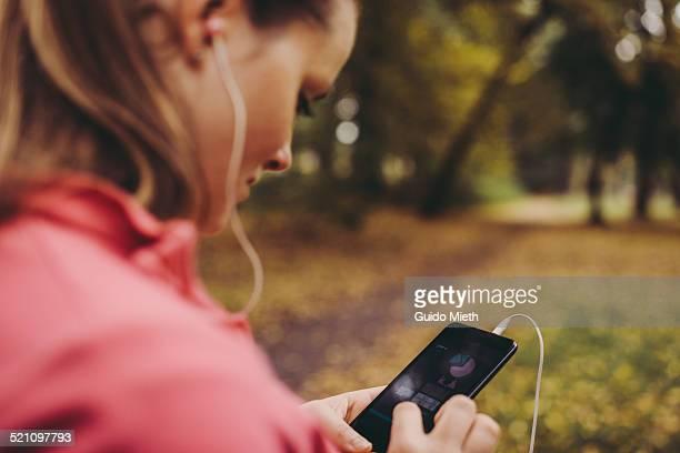 Woman checking self tracking app.