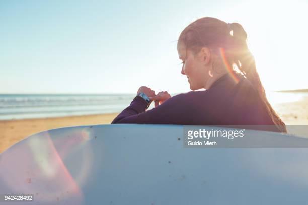 Woman checking smartwatch.
