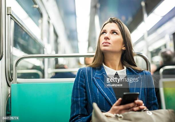 Woman Checking Subway Station Name Before Getting Off
