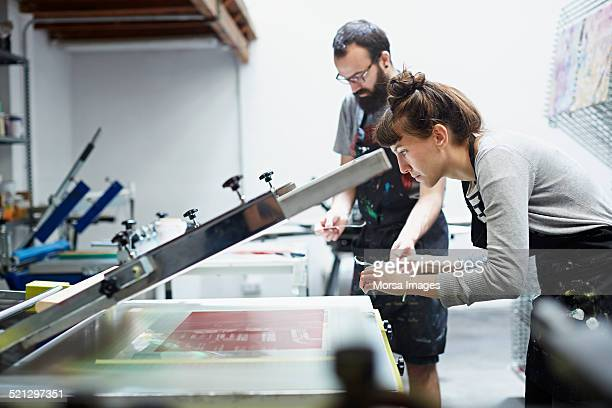 Woman checking the results of the printing process