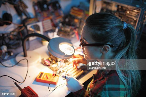 Woman checking voltage