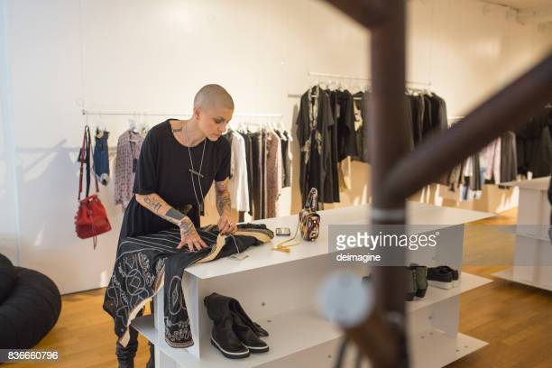 Woman checks dress in clothes shop