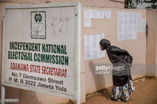 A woman checks her name in voting lists at the State INEC Independent Electoral Comission Office in Jimeta on February 16 2019 Nigeria's electoral...