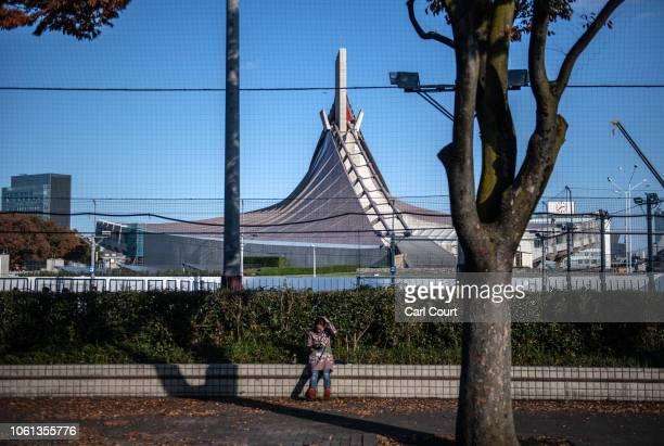 Woman checks her phone near Yoyogi National Stadium on November 14, 2018 in Tokyo, Japan. The 13,291 seat stadium is set to host handball during the...