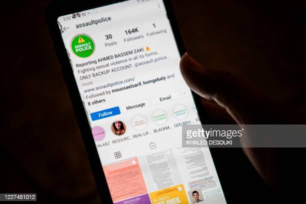 Woman checks on her phone an Instagram account for reporting allegations of sexual harassment and misconduct against Ahmed Bassam Zaki, a 22-year-old...